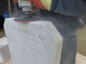 Headstone being restored in Diss Norfolk